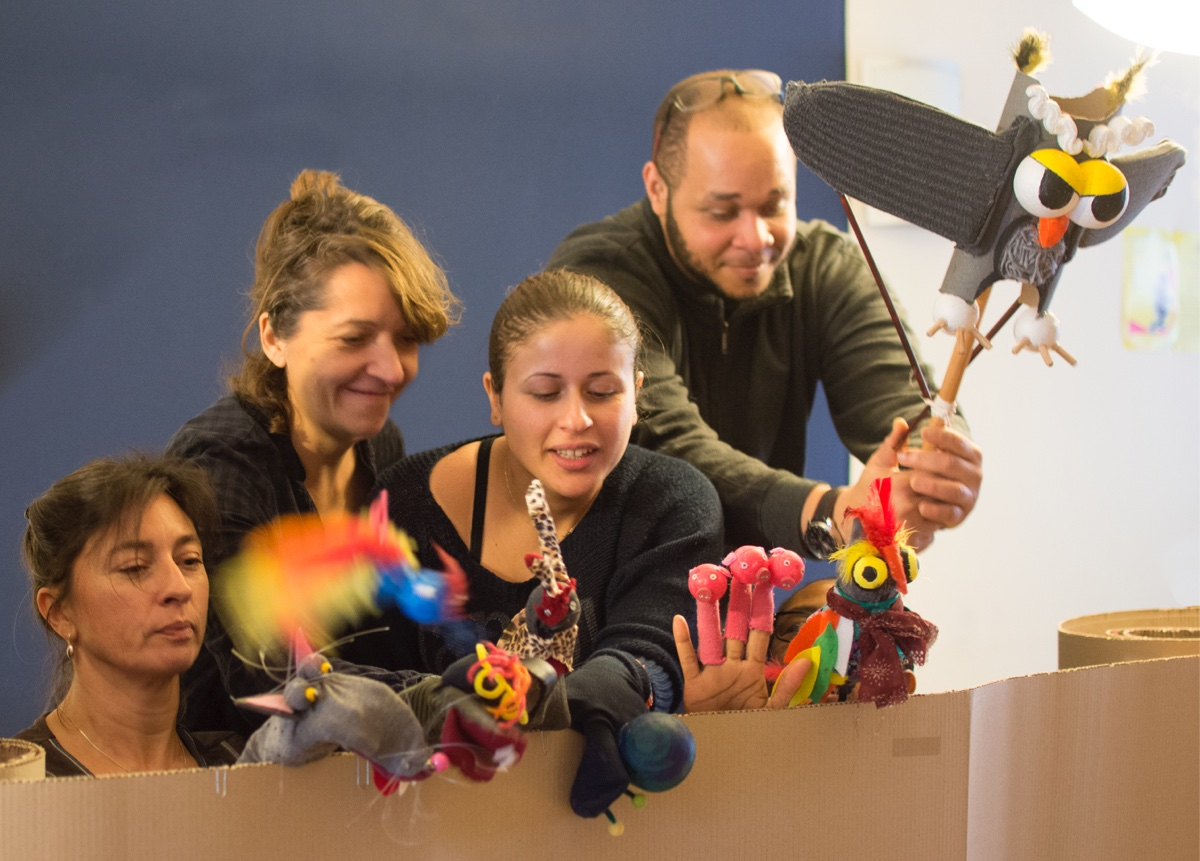 Participants stage fabrication marionettes